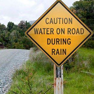 caution water on road during rain